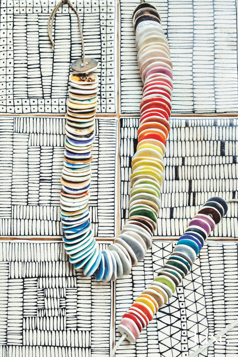 A strand of glaze samples upon her handmade tiles.