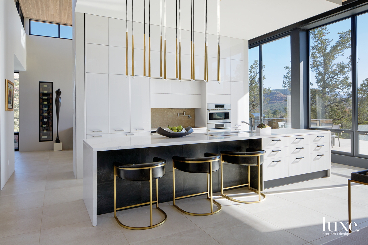 contemporary white kitchen with black...