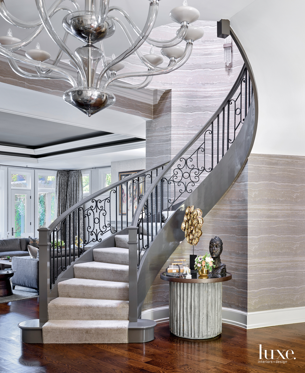 transitional gray staircase glass chandelier