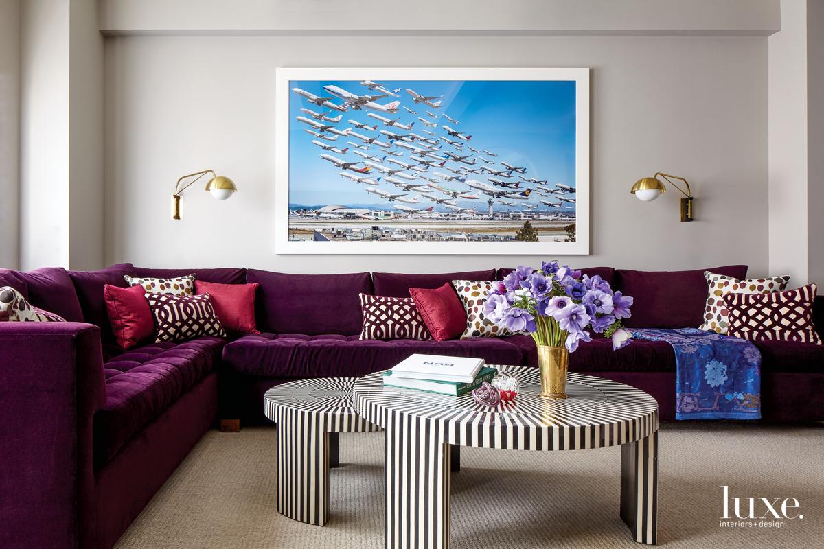 eclectic sitting area purple sofa...