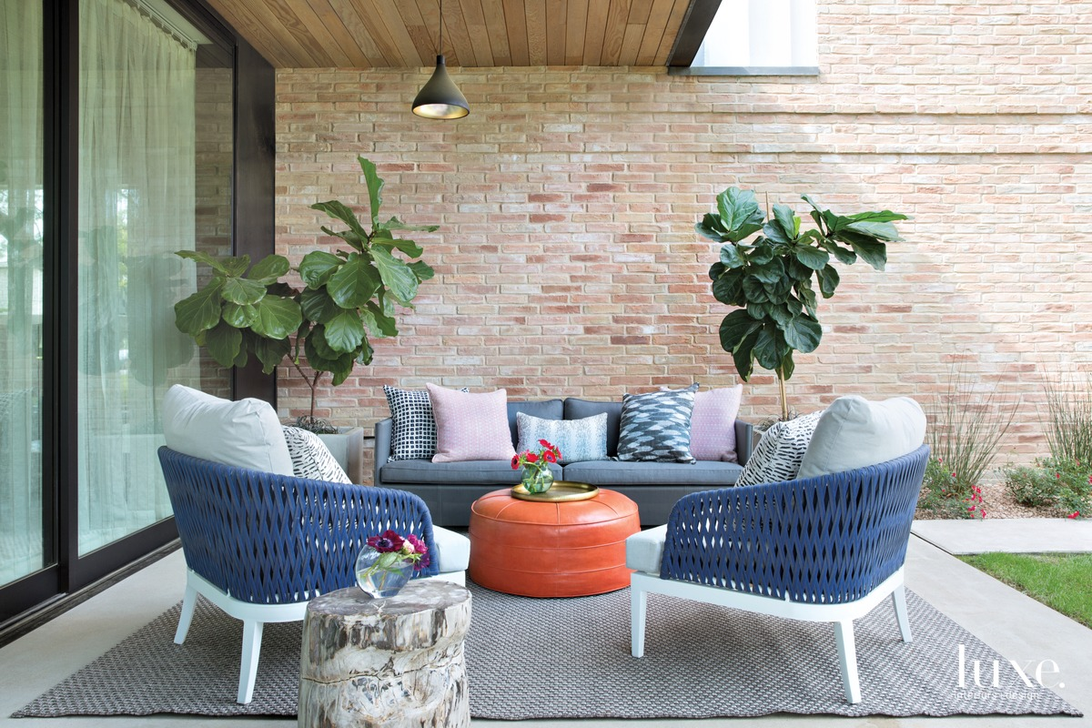 eclectic outdoor sitting area orange...