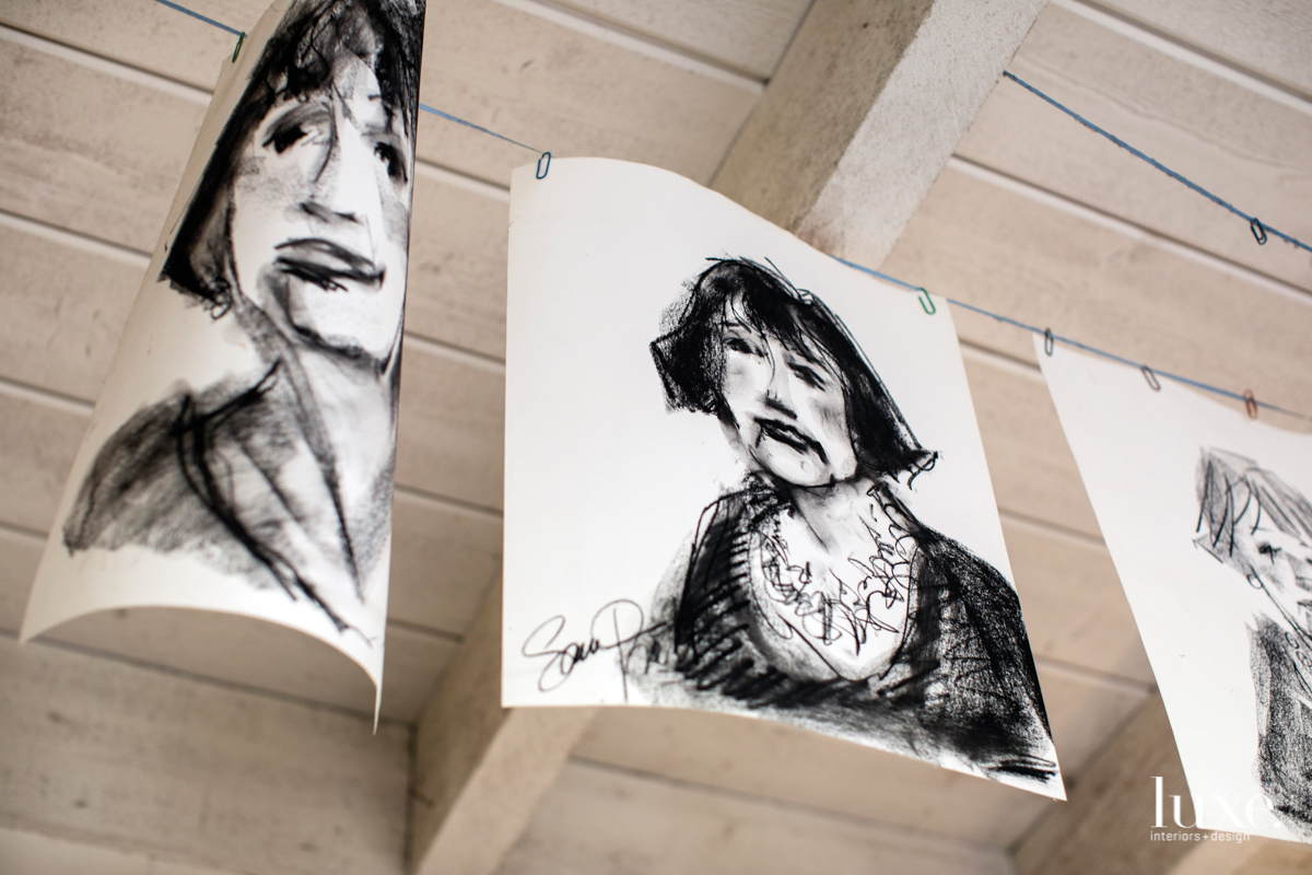 Charcoal portraits by Pratt show Geny Dignac, a local light and fire artist.