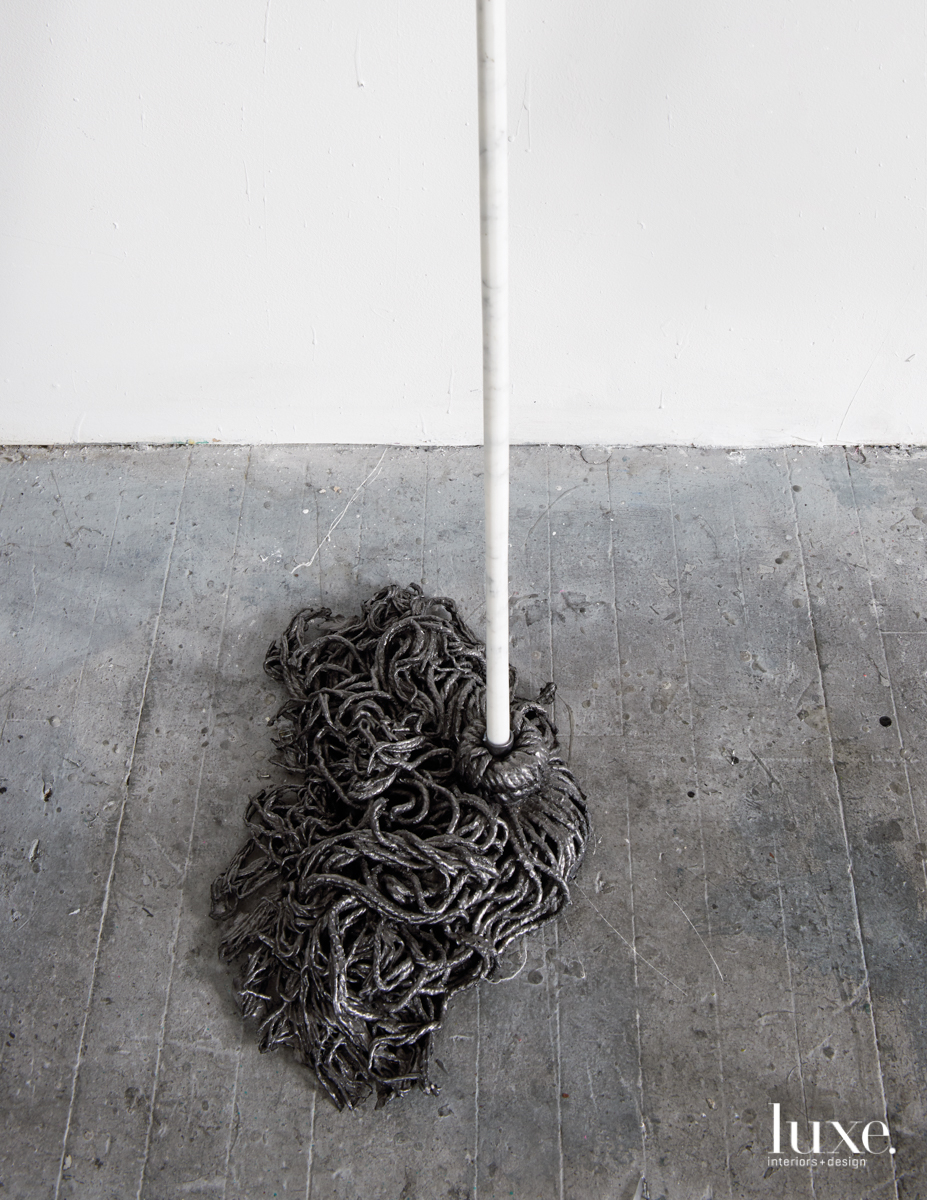 "The marble-handled hardened mop is part of Seiden's ""Invisible Labor"" series."