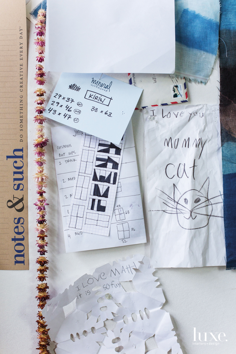 On the studio wall are notes and sketches providing inspiration and encouragement.
