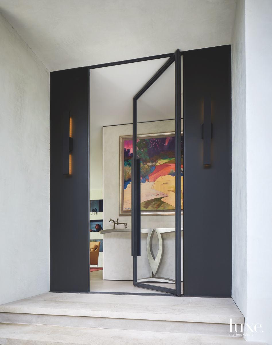 contemporary exterior entry black-framed glass...