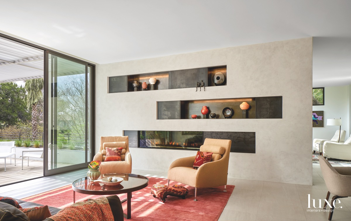 contemporary living area fireplace and...
