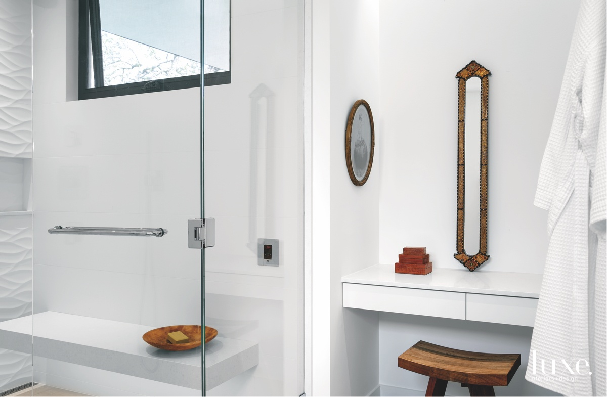 contemporary white bathroom brown stool...