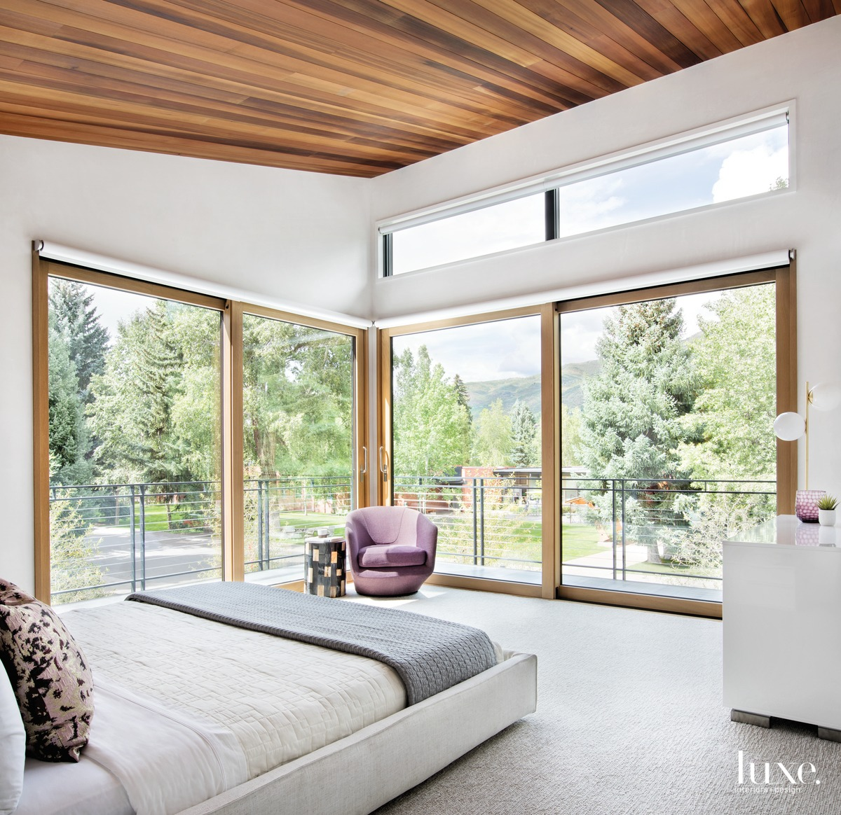 modern neutral bedroom glass windows...