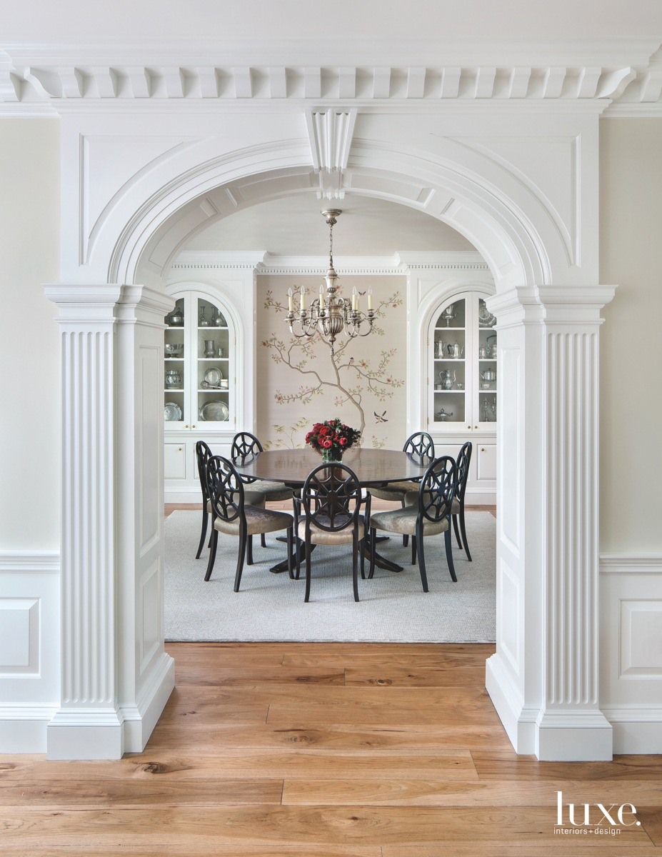 modern dining room white archway...