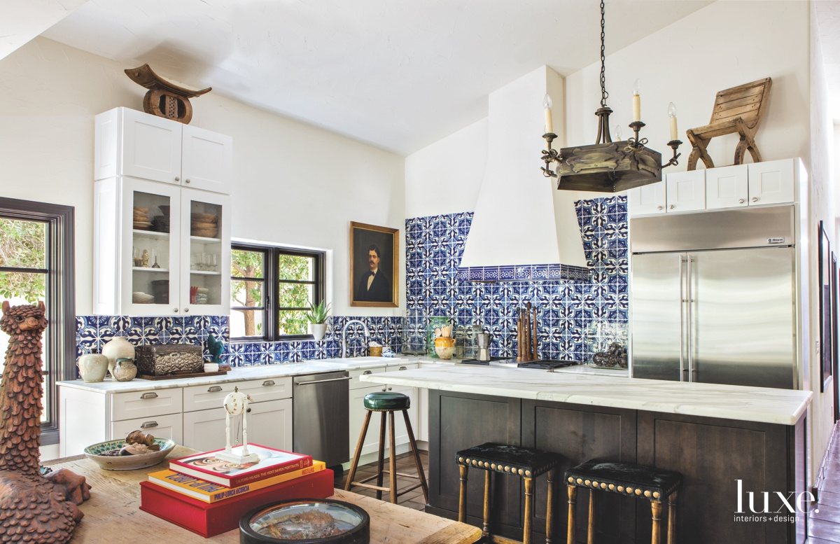 modern kitchen blue backsplash black...