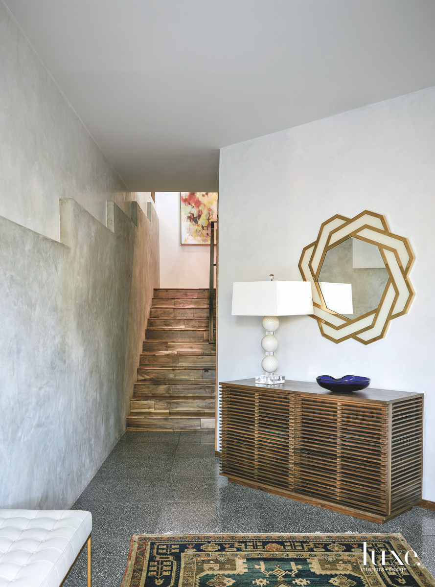 contemporary entry staircase gold accents