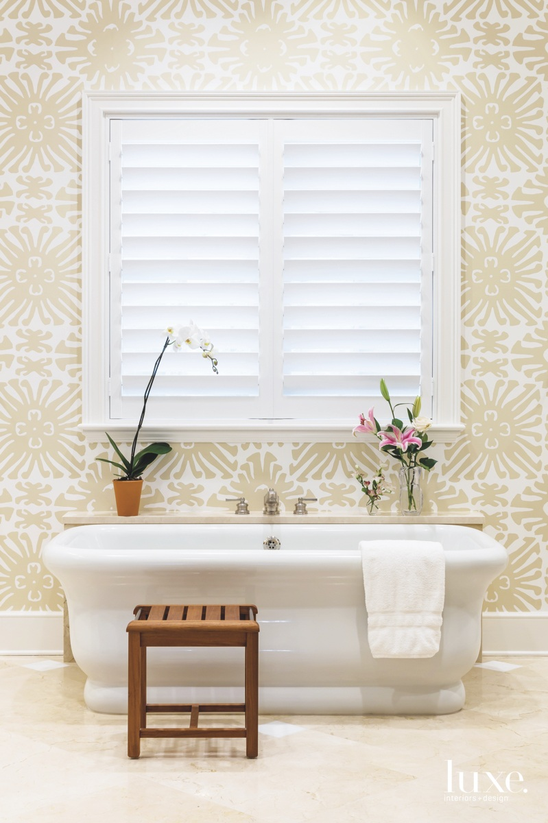 traditional bathroom white bathtub neutral...