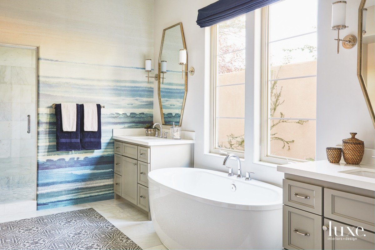 modern bathroom ocean-like wallcovering gold-framed...