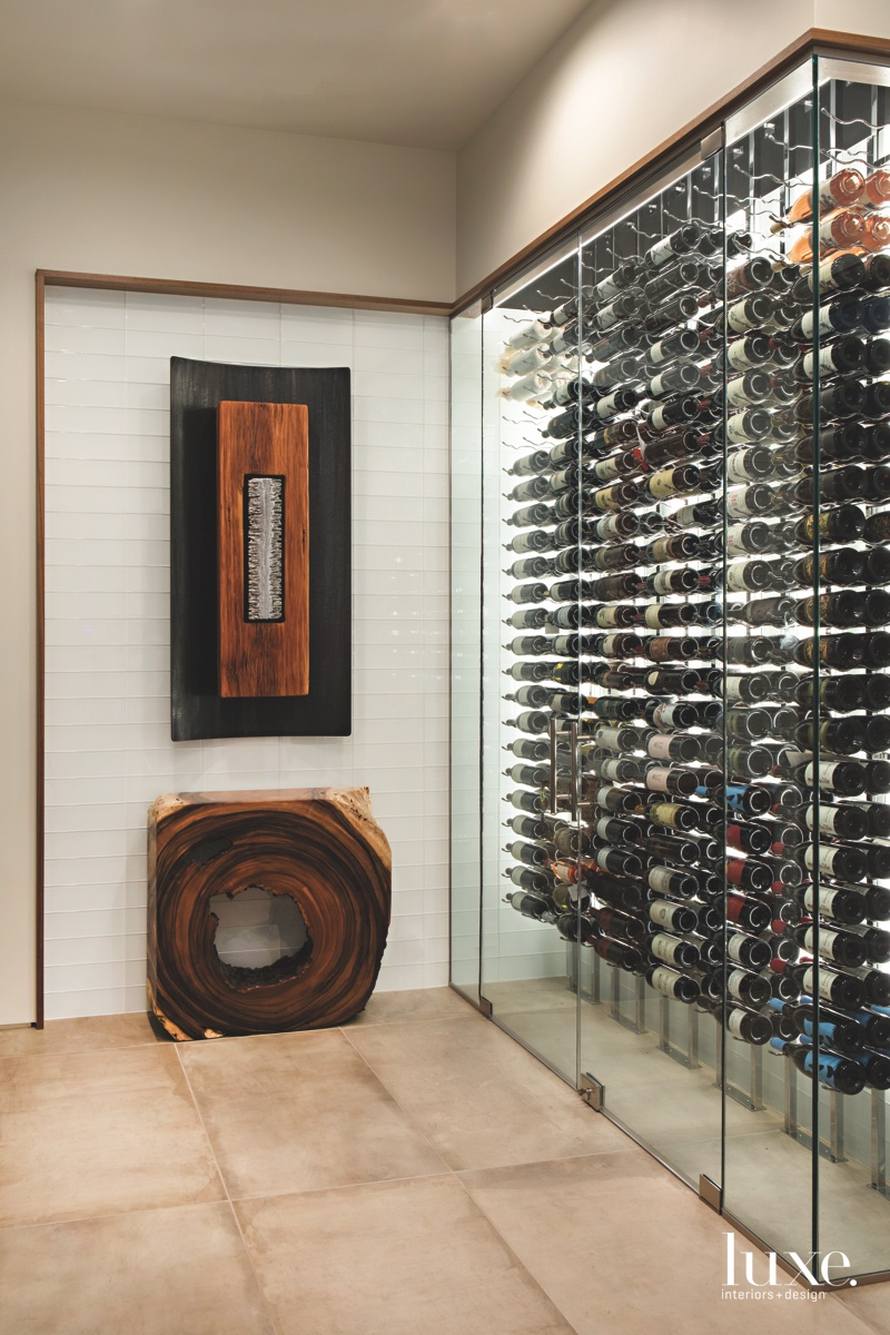 A lower-level wine room with...