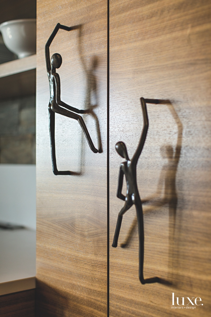 modern kitchen cabinetry figural hardware