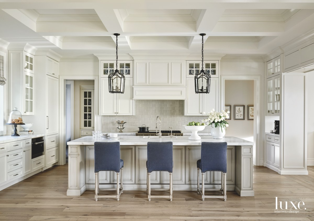 traditional white kitchen navy counter...