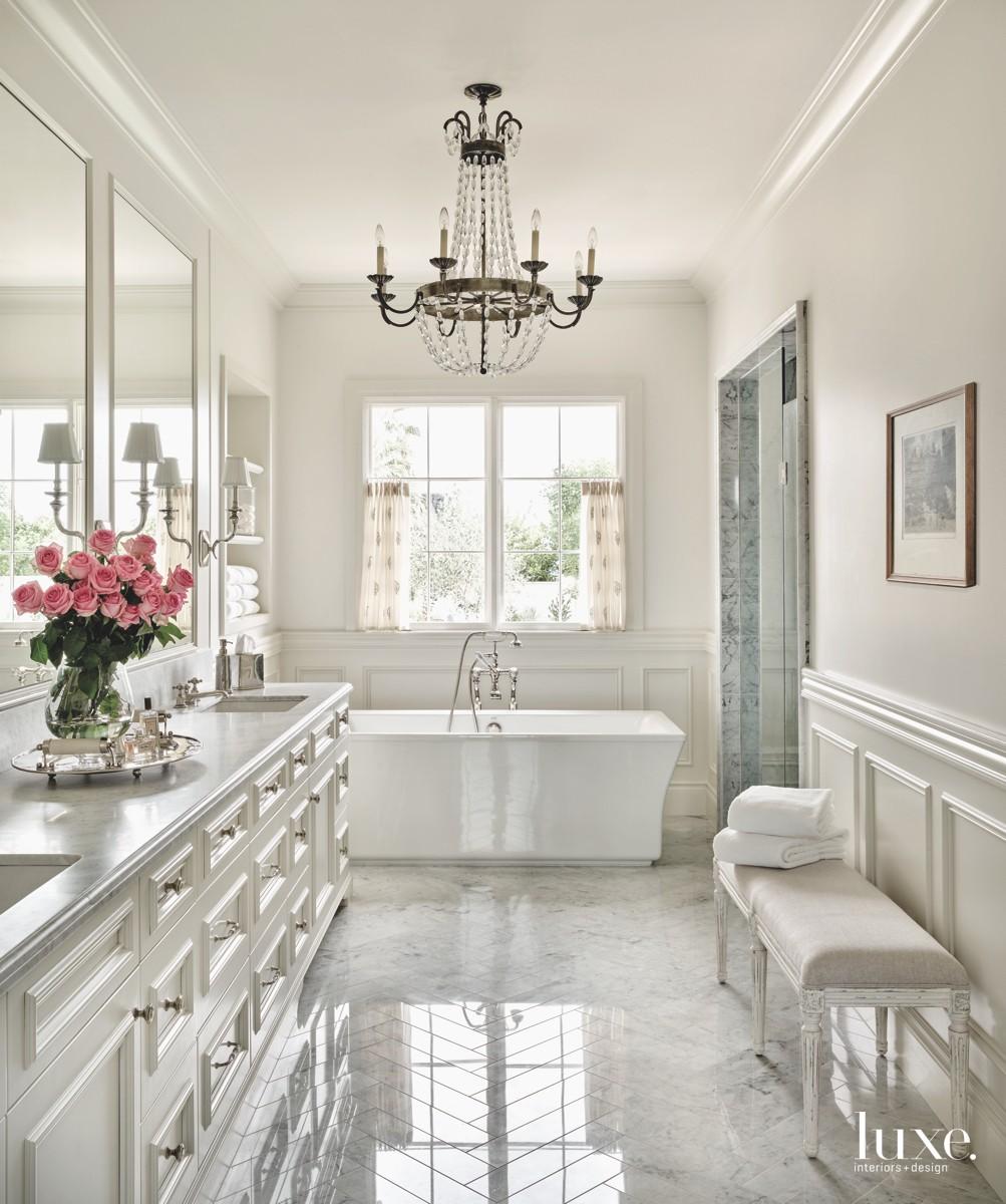 traditional white bathroom white tub