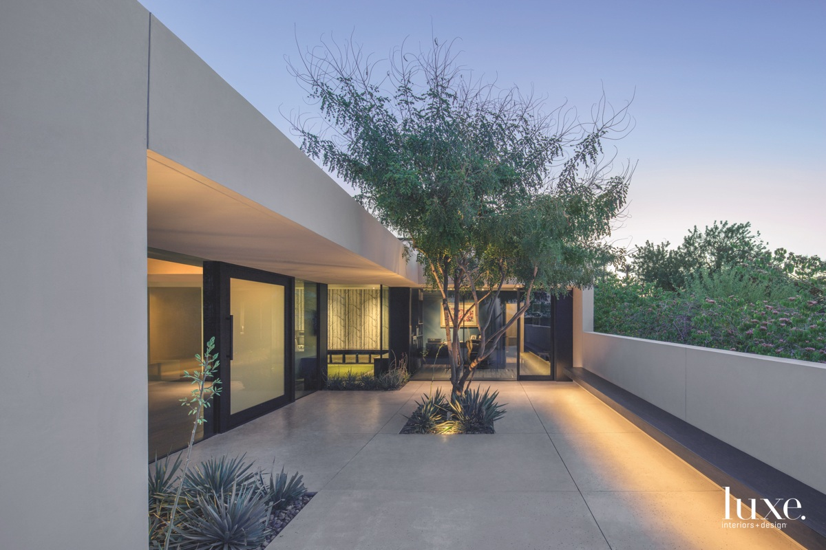 modern exterior walkway white stucco...