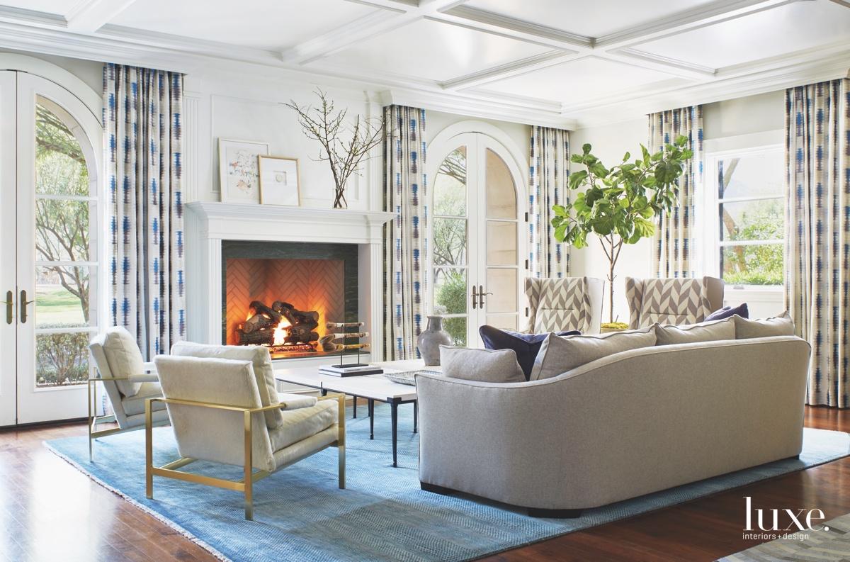 mediterranean living room fireplace blue...