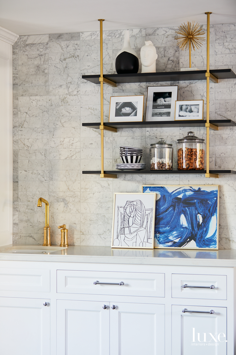 contemporary kitchenette white cabinetry gold...