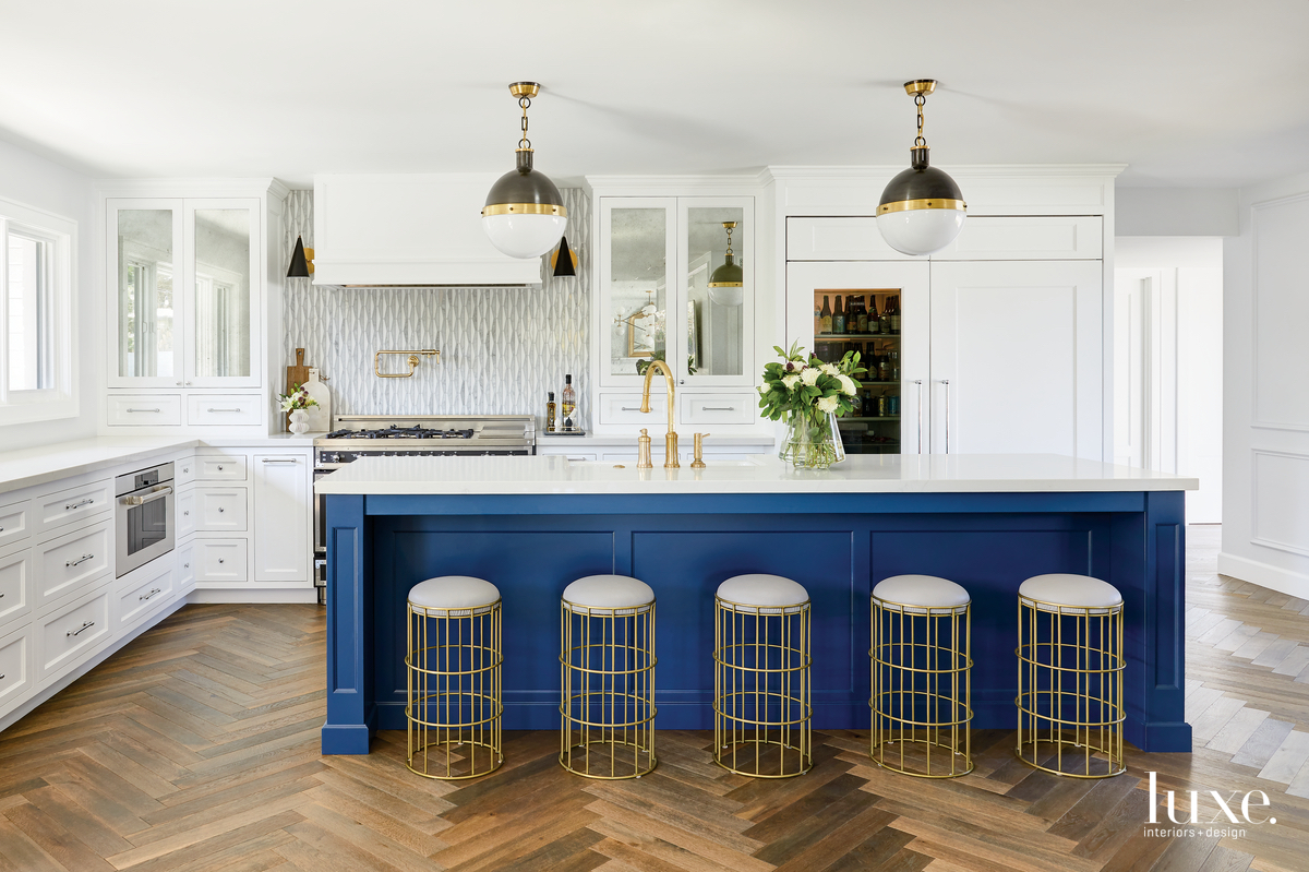 contemporary white kitchen blue island...