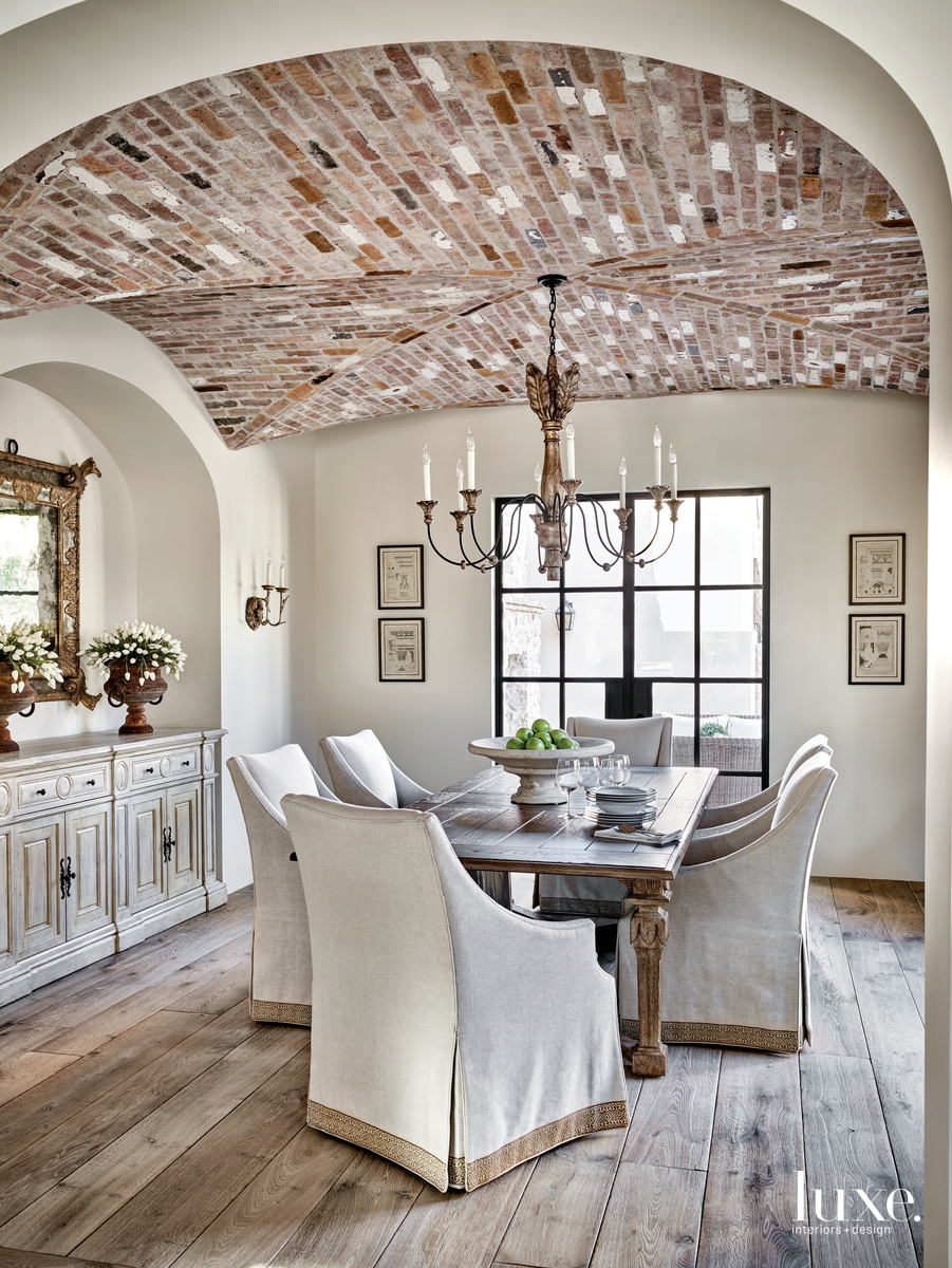 traditional neutral dining room brick...