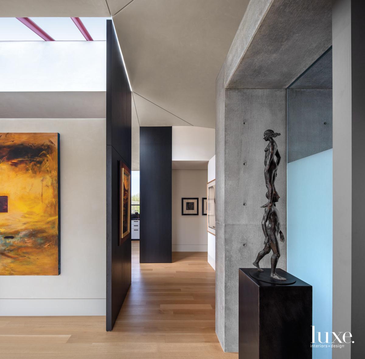 modern neutral hallway bronze sculpture