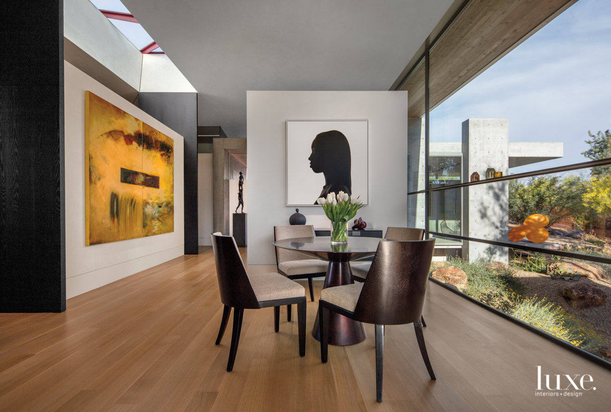 modern dining area floor-to-ceiling windows