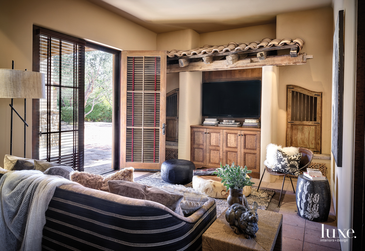 transitional living room brown accents...