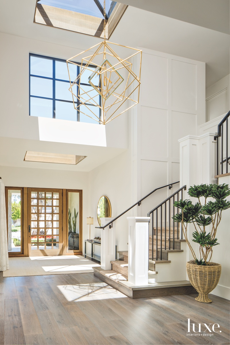 contemporary neutral entry staircase gold...