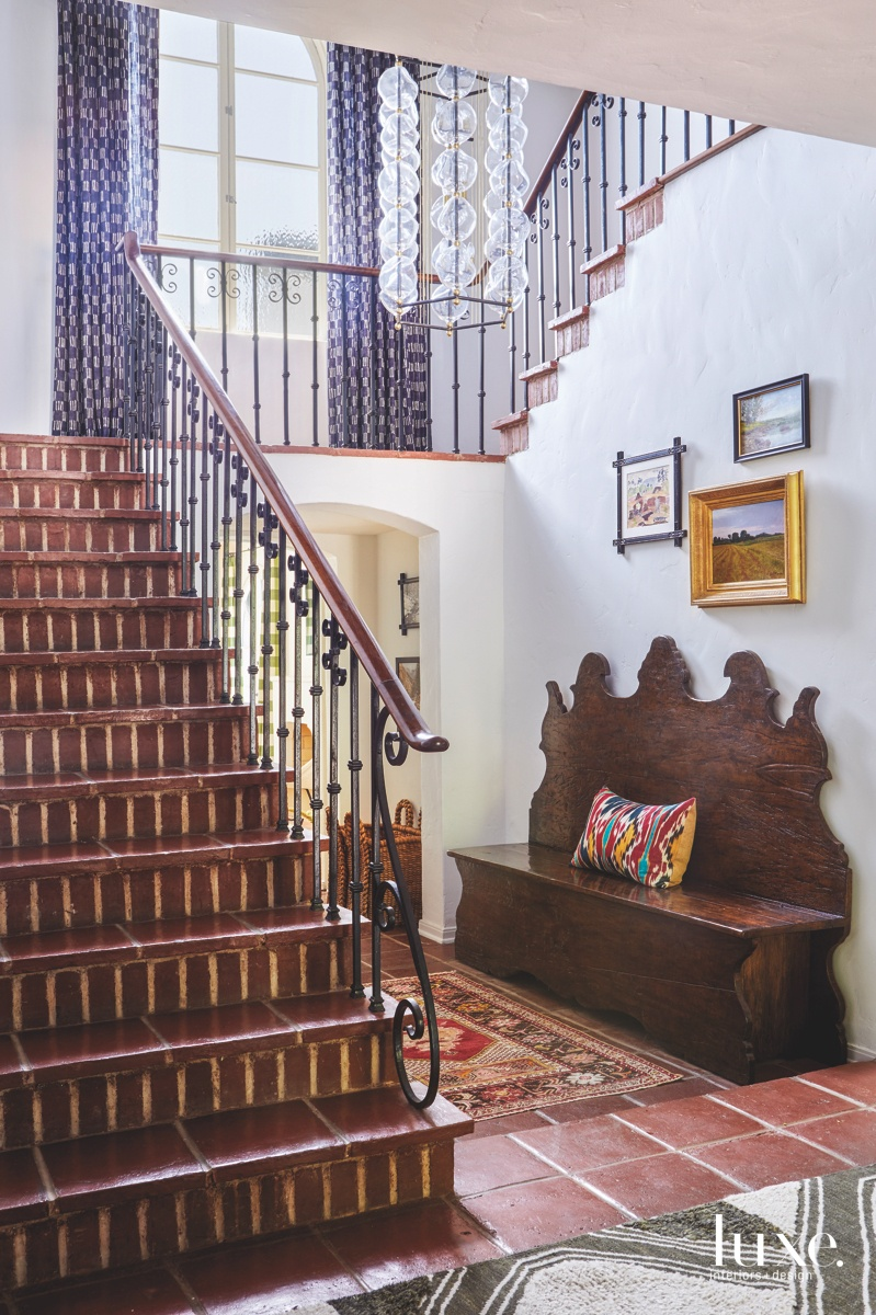 eclectic entry brown staircase whimsical...