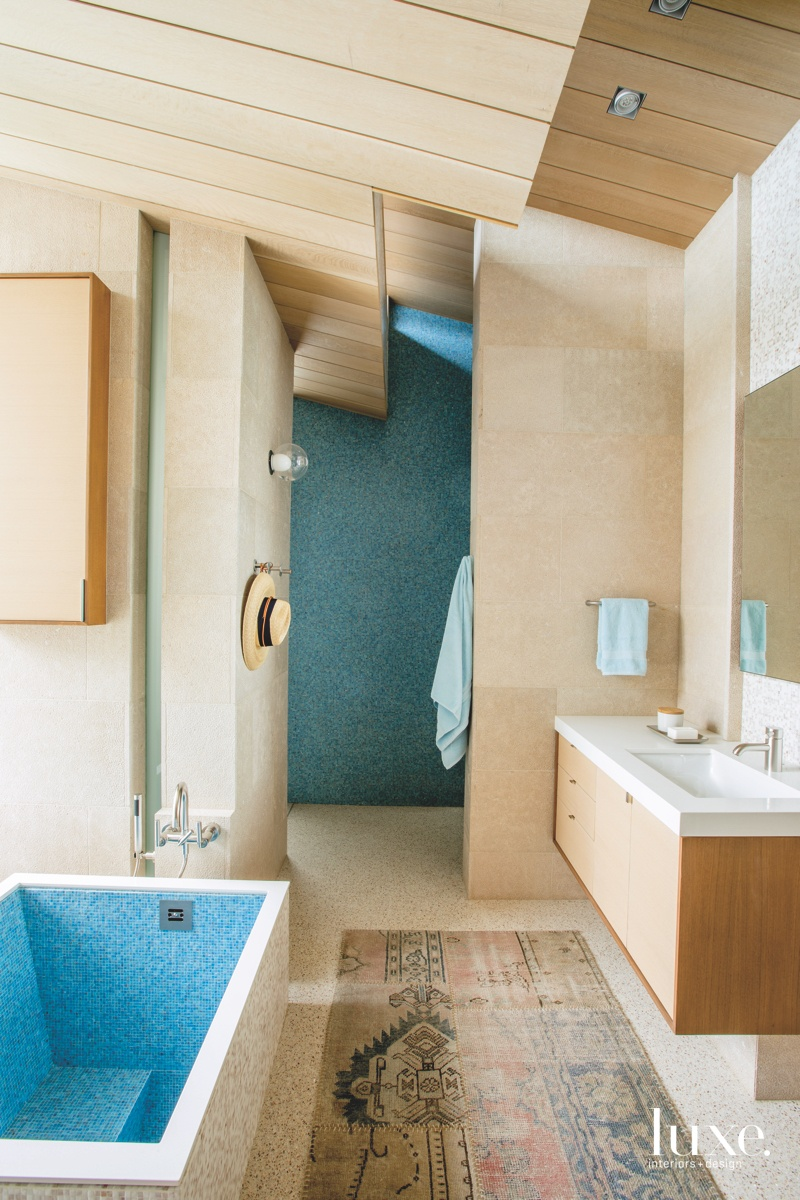 contemporary neutral bathroom blue tile...