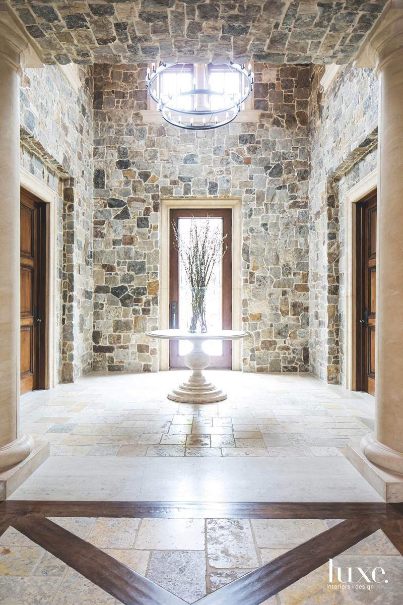 mediterranean foyer stone walls