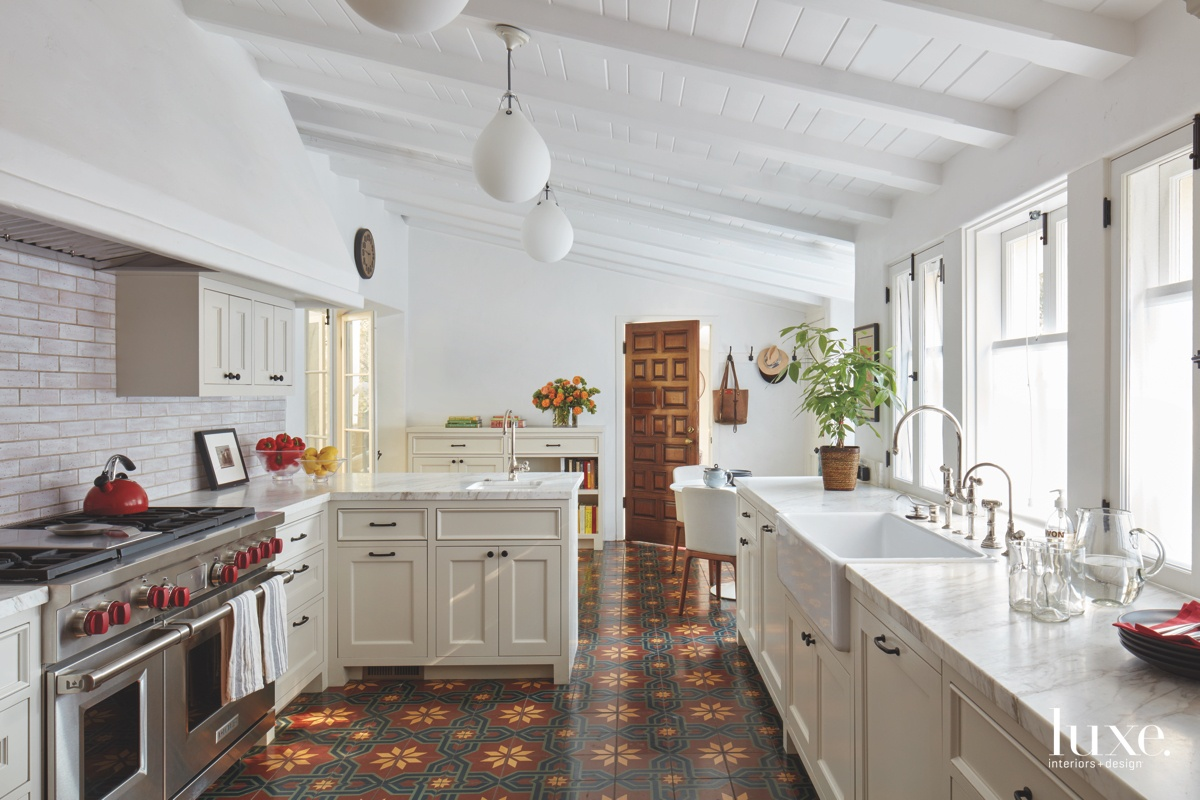 transitional white kitchen encaustic tile...