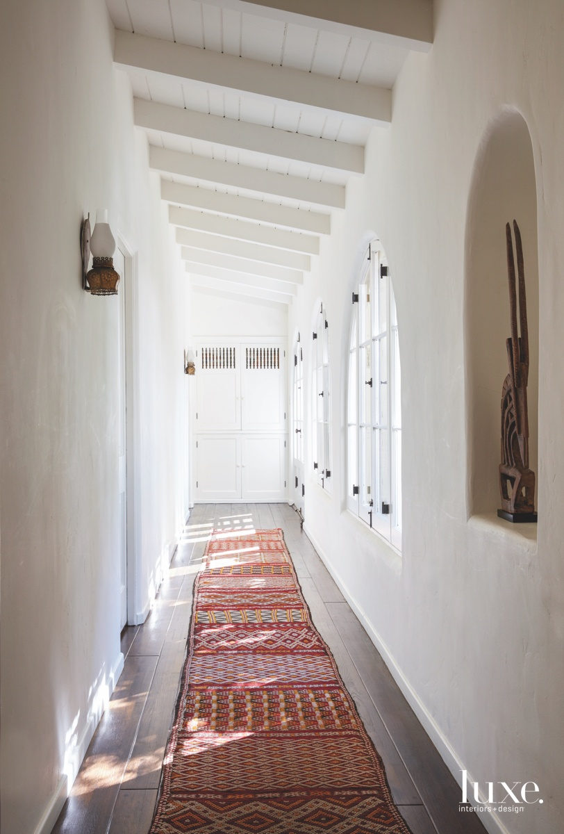 transitional white hallway red Moroccan...