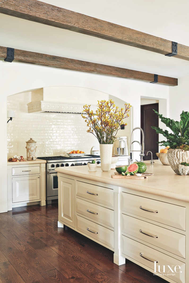 transitional off-white kitchen cabinetry island
