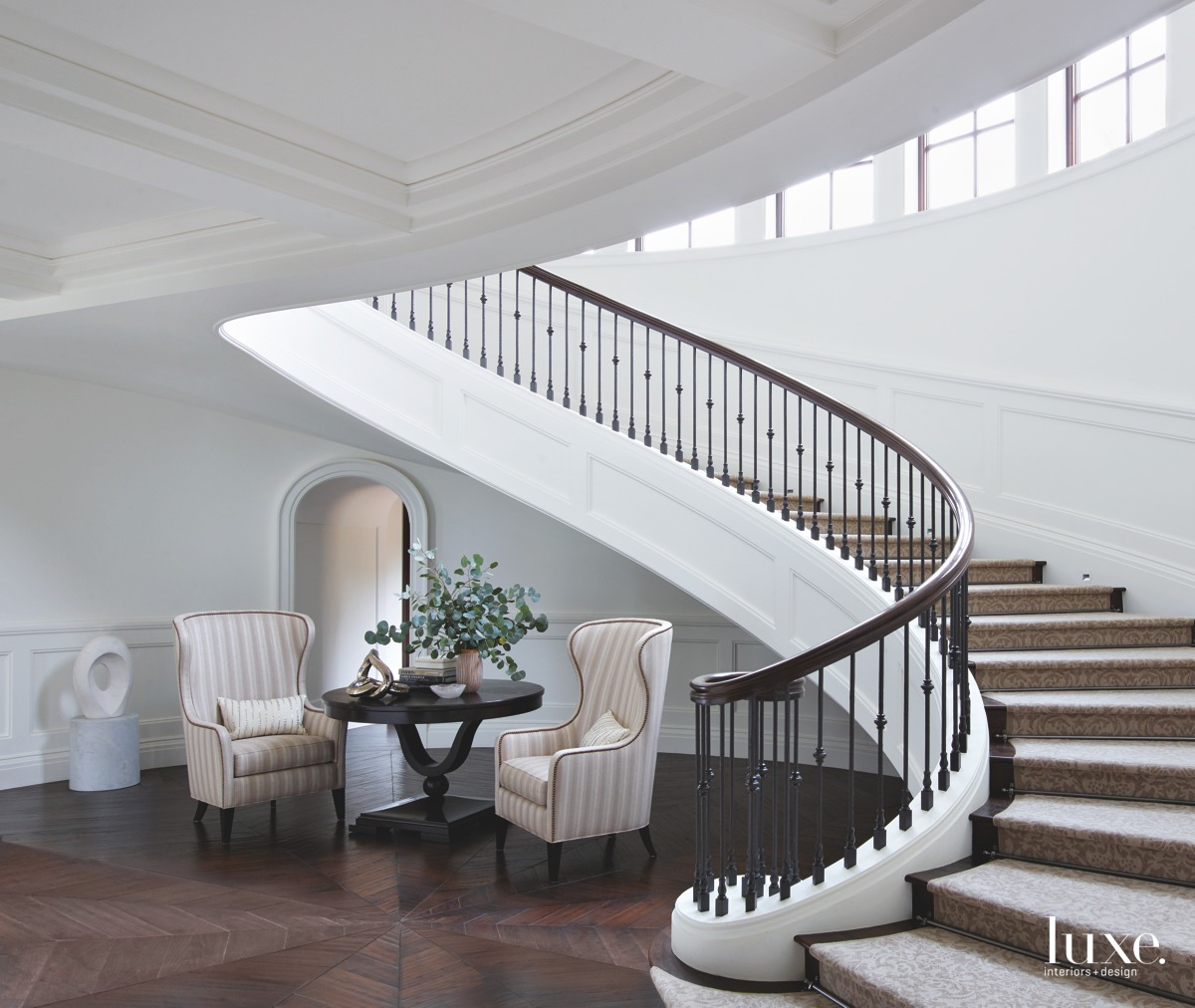 mediterranean stair hall wingback chairs