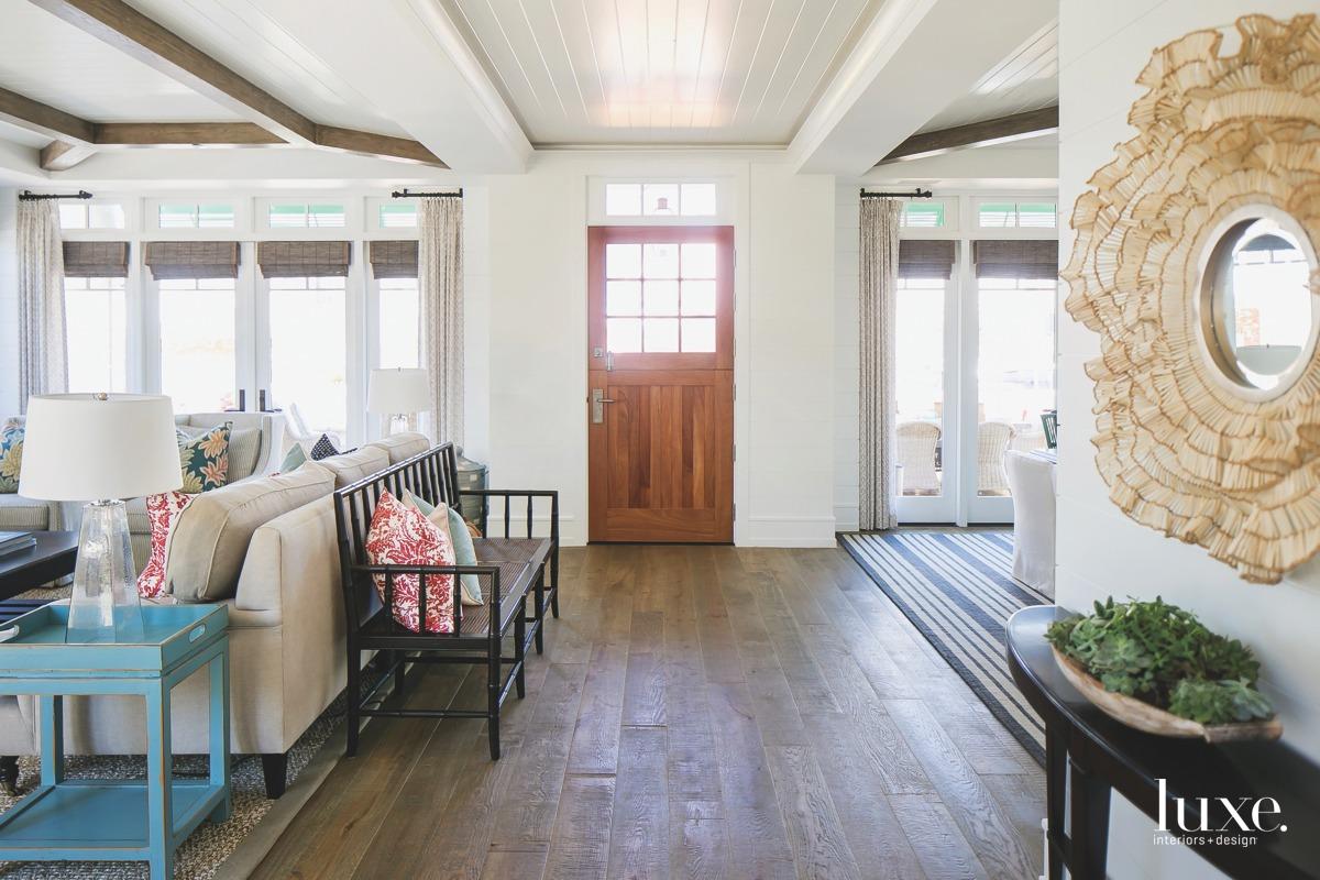coastal entry open mahogany door