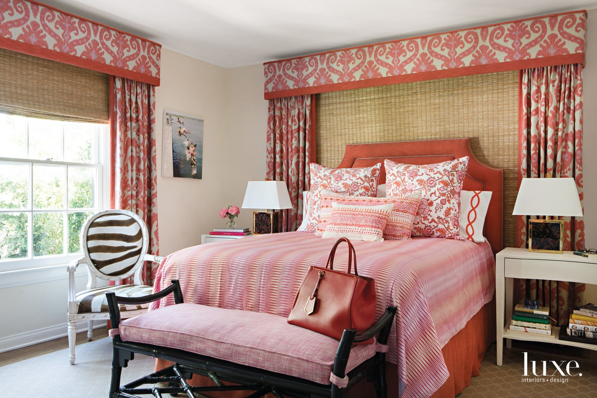 traditional pink guest bedroom bed