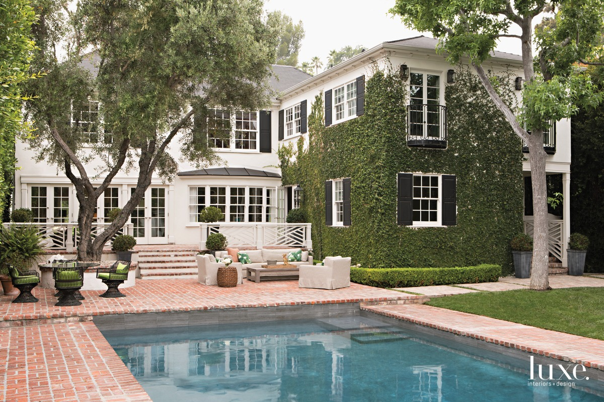 traditional white exterior and pool