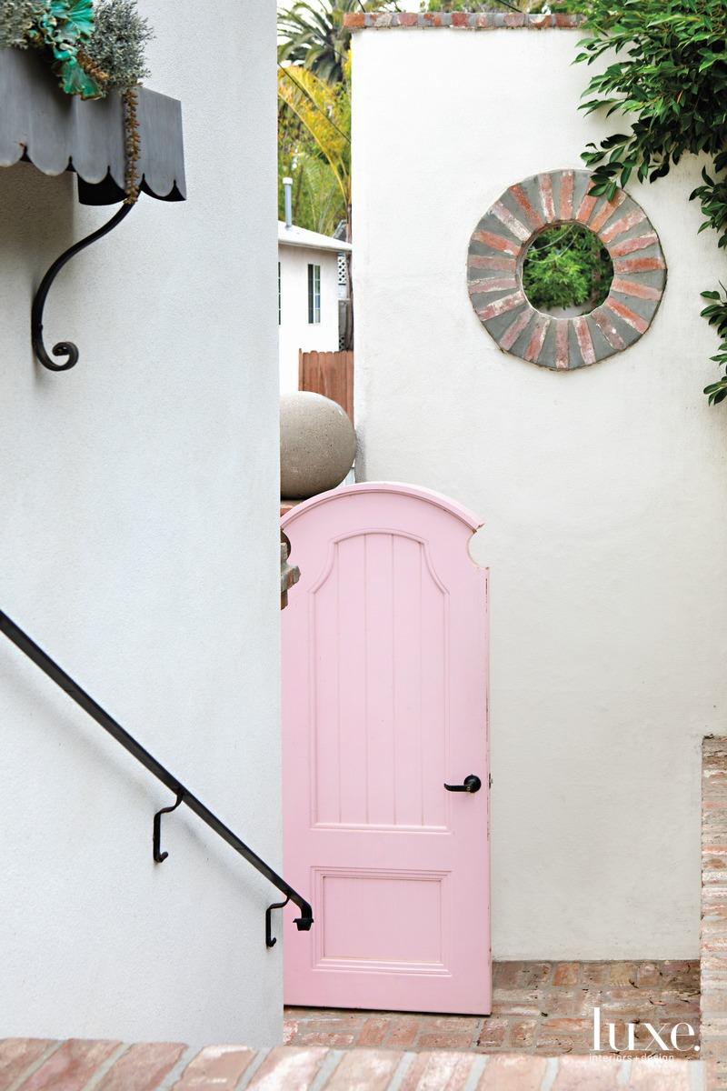 traditional entry pink door