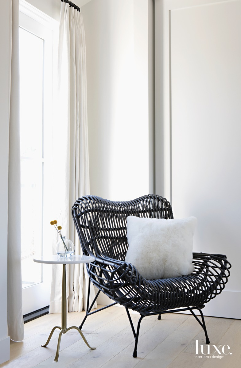 farmhouse bedroom black-wicker lounge chair...