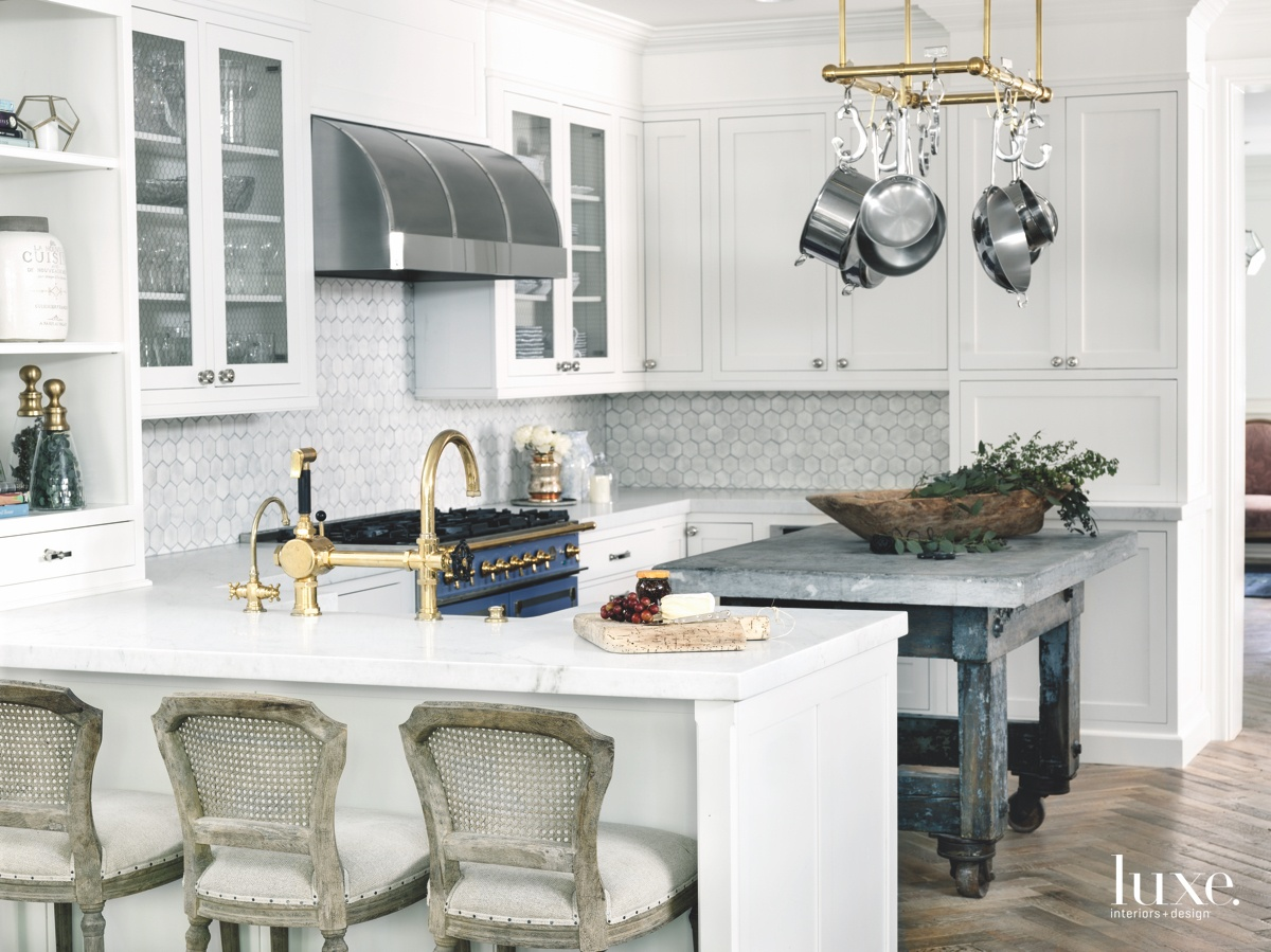 transitional kitchen white cabinetry brass...