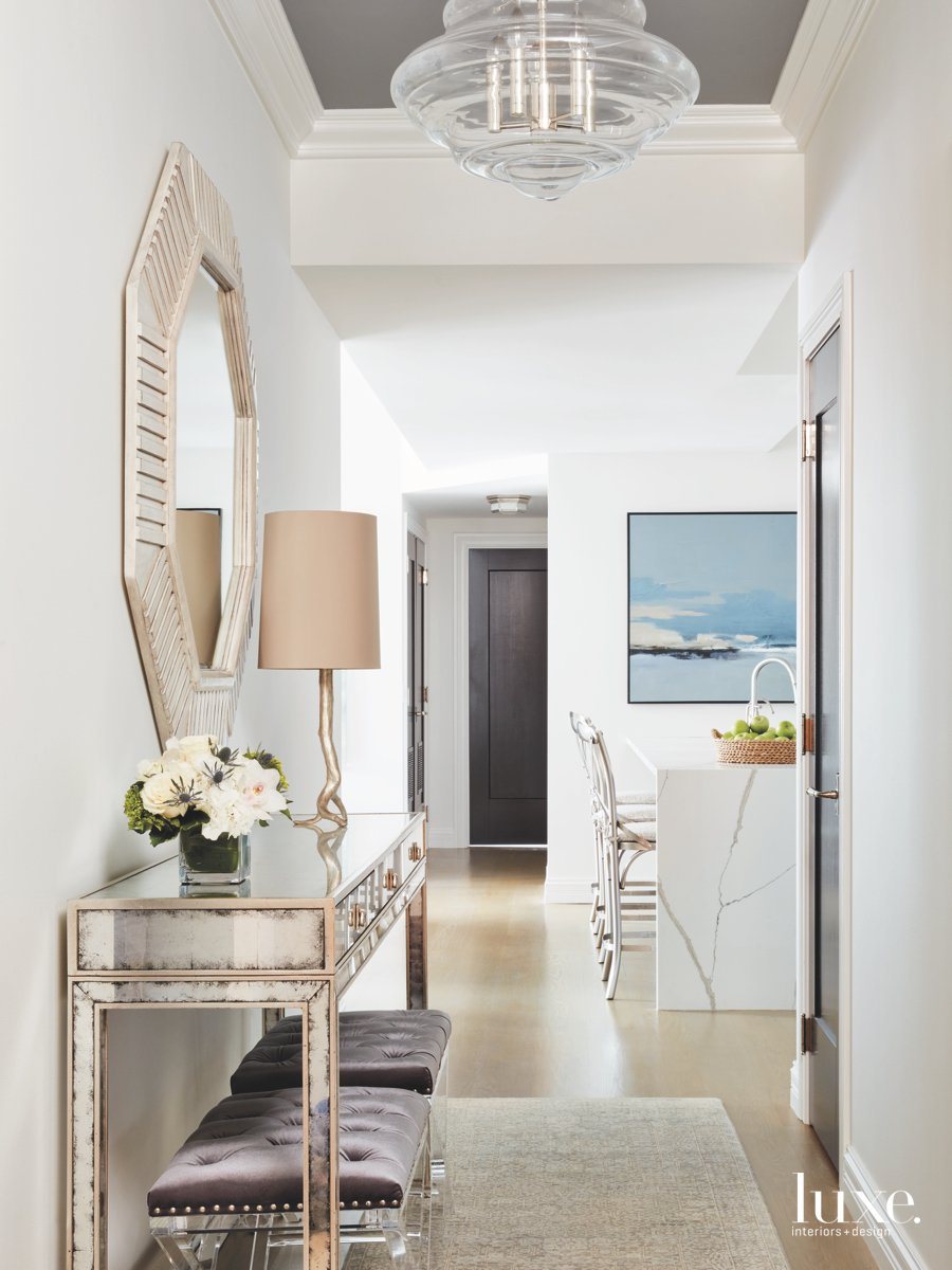 contemporary entry hall neutral stools...