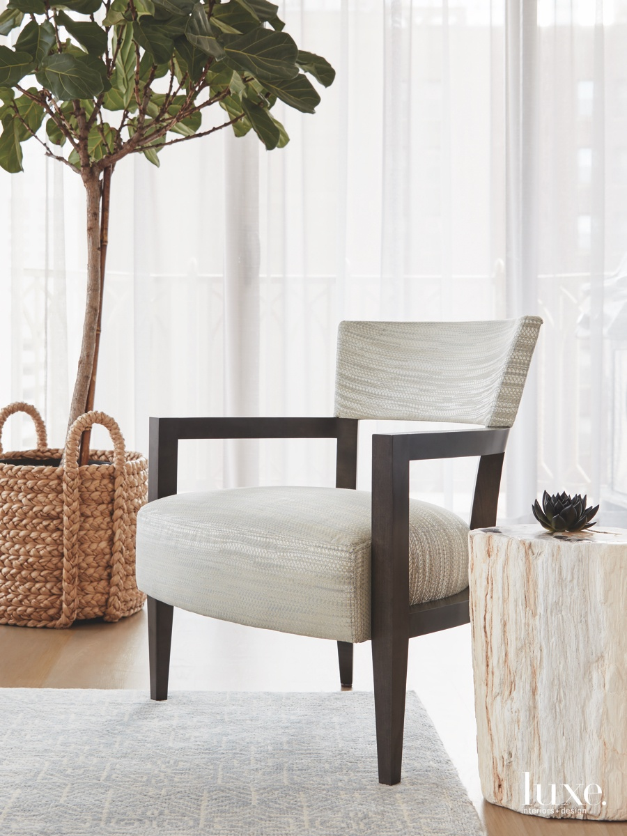 contemporary living room wood-framed armchair...