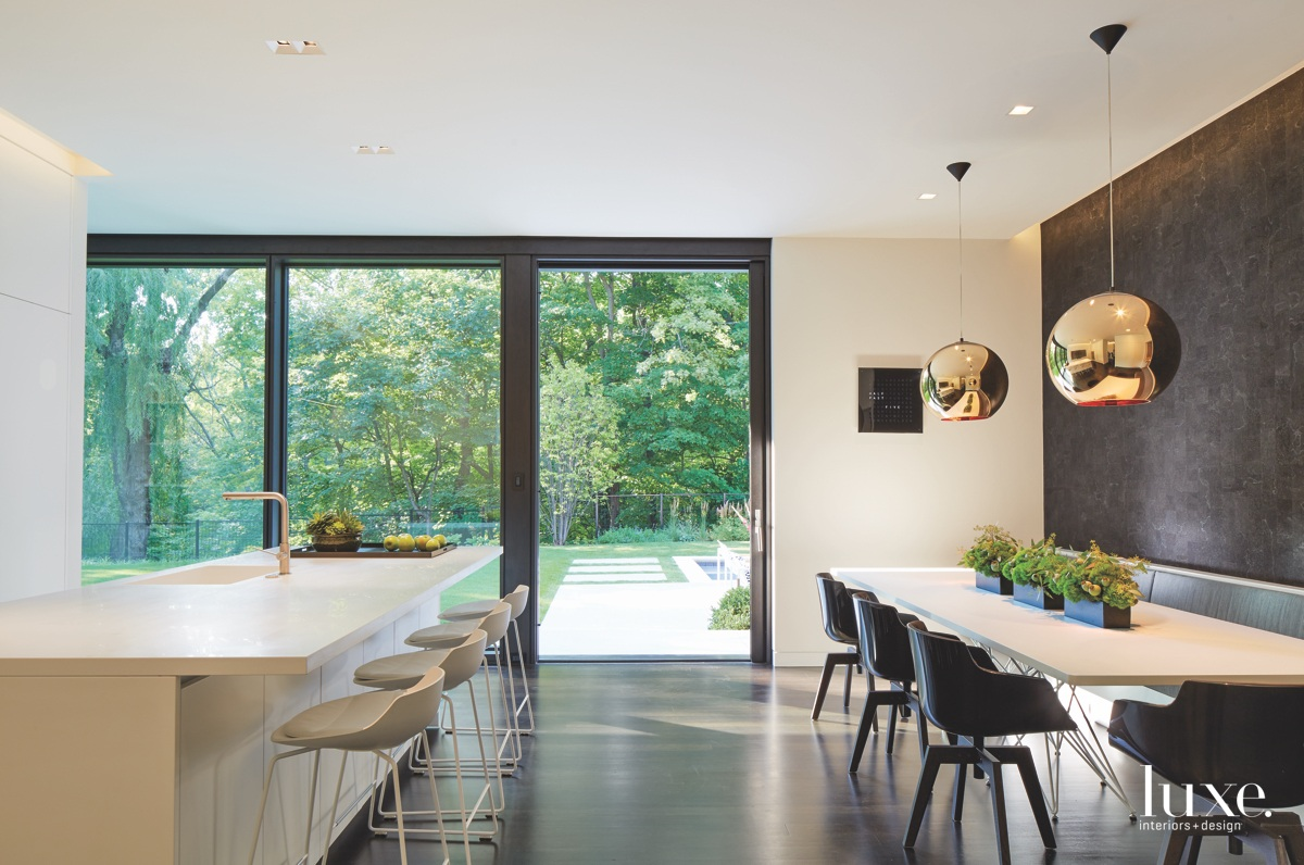 modern white kitchen and dining...