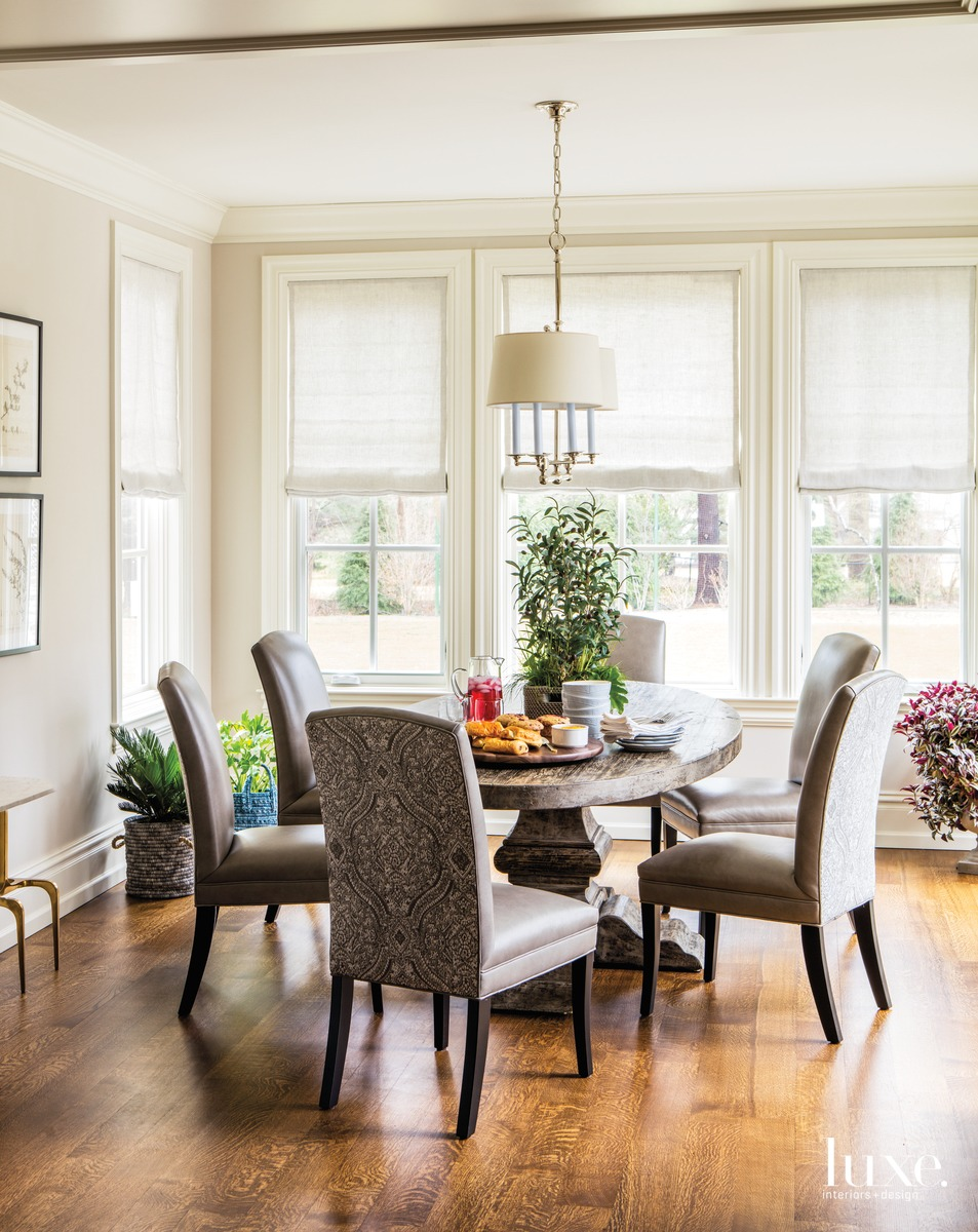 traditional neutral dining area round...