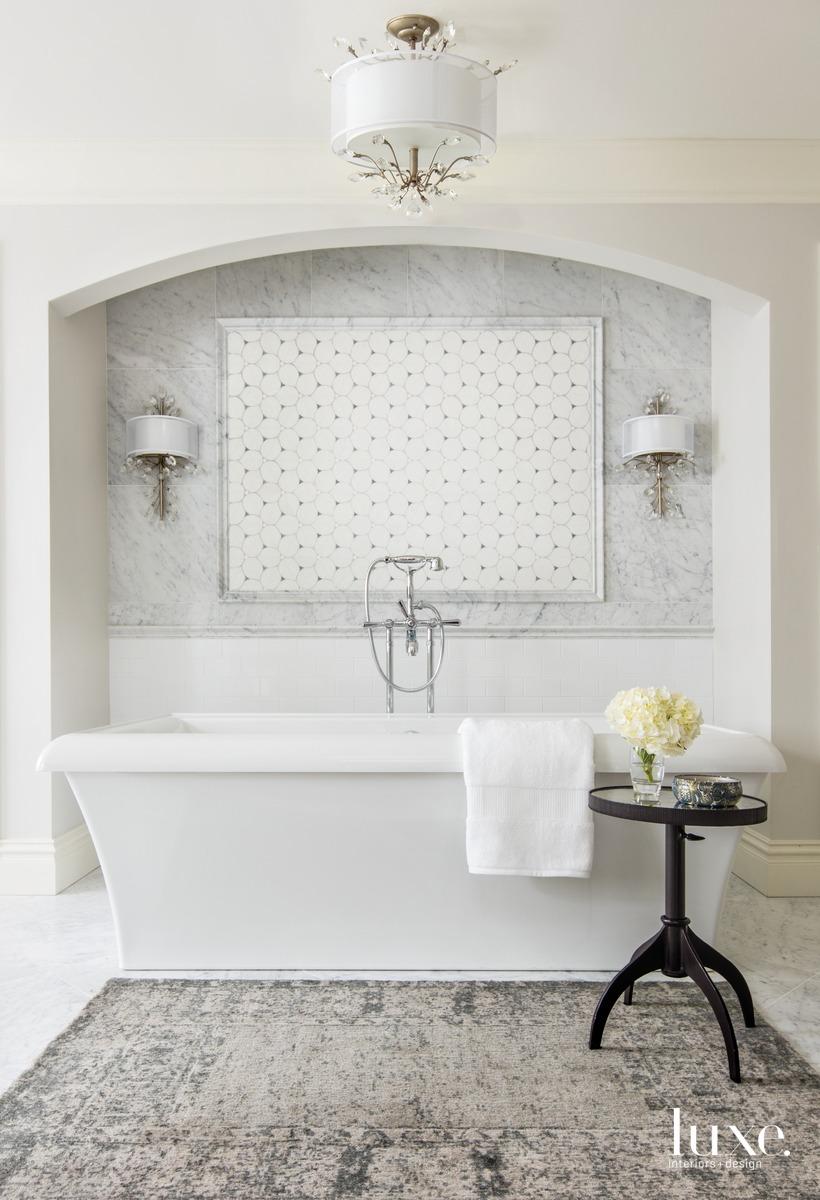 traditional bathroom white tub rug
