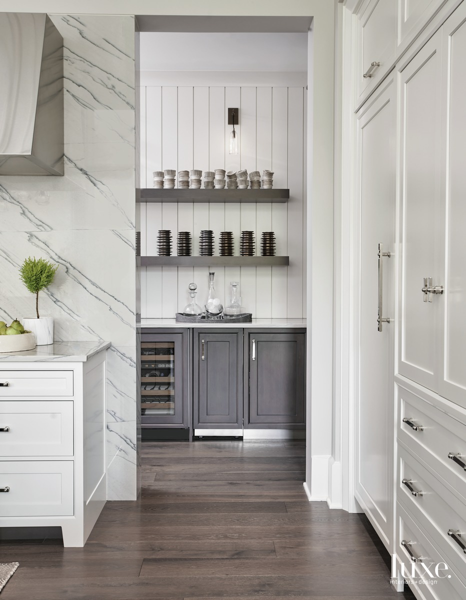 traditional white kitchen with dark...