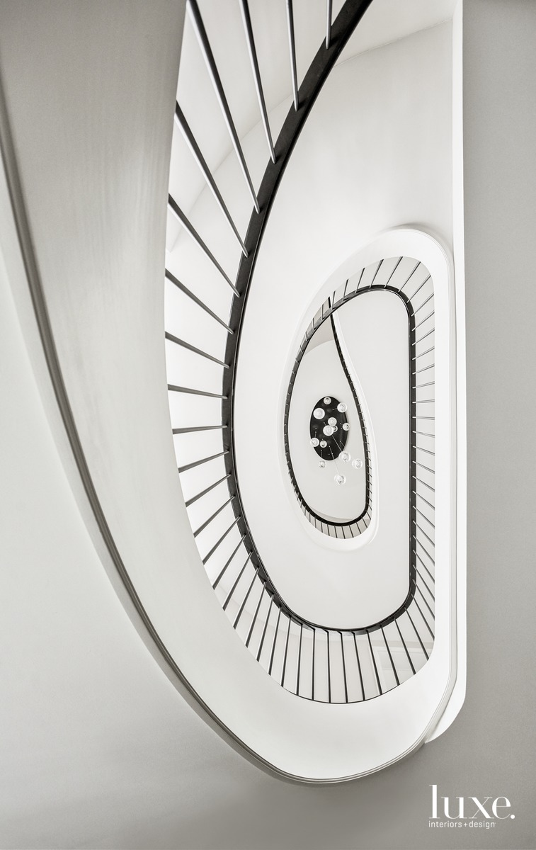 spiral staircase white with black...